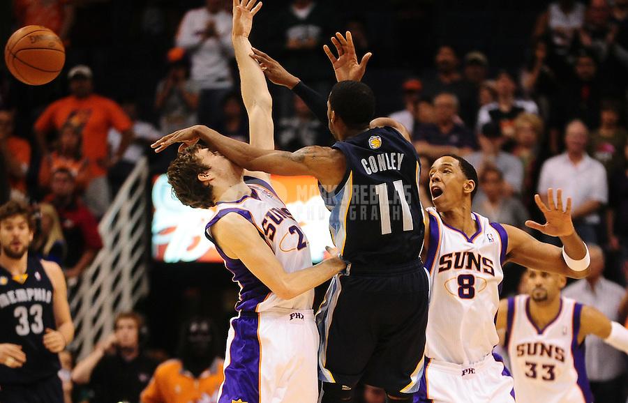 Dec. 8, 2010; Phoenix, AZ, USA; Memphis Grizzlies guard (11) Mike Conley hits the face of Phoenix Suns guard (2) Goran Dragic as center (8) Channing Frye looks on at the US Airways Center. Memphis defeated Phoenix 104-98 in overtime. Mandatory Credit: Mark J. Rebilas-