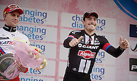 A very happy race winner  John Degenkolb (DEU/Giant-Alpecin) on the podium next to the previous winner Alexander Kristoff (NOR/Katusha)<br /> <br /> 106th Milano - San Remo 2015