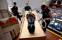 BOGOTA, COLOMBIA - MAY 14: Workers make a demonstration of a hospital bed which in case to be needed can be used as a coffin in Bogota, May 14, 2020. The bed was designed by a Colombian company for COVID-19 patients amid the new coronavirus pandemic that infected 12.930 people and claimed 509 lives in the country.(Photo by Leonardo Munoz/VIEWpress)