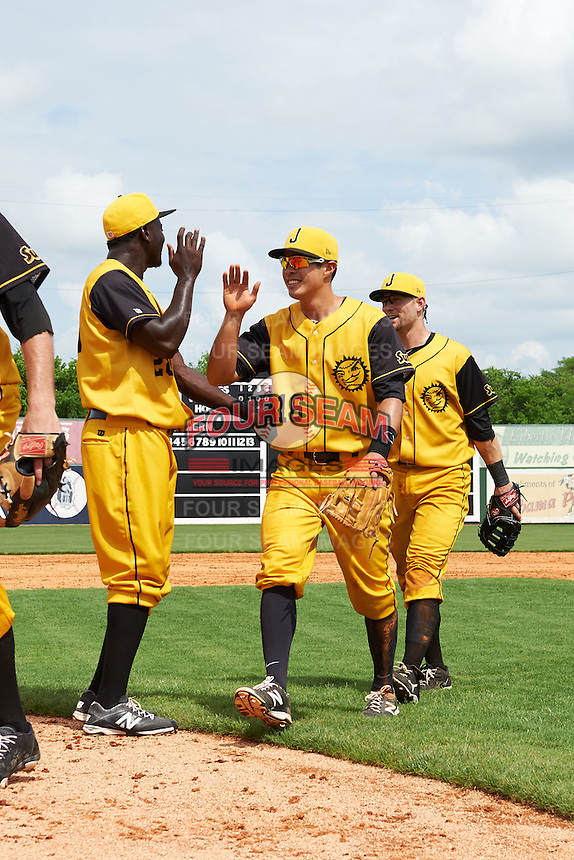 Jacksonville Suns pitcher Juancito Martinez (28) fist bumps Terrence Dayleg (16) and David Adams (35) after the 20th Annual Rickwood Classic Game against the Birmingham Barons on May 27, 2015 at Rickwood Field in Birmingham, Alabama.  Jacksonville defeated Birmingham by the score of 8-2 at the countries oldest ballpark, Rickwood opened in 1910 and has been most notably the home of the Birmingham Barons of the Southern League and Birmingham Black Barons of the Negro League.  (Mike Janes/Four Seam Images)