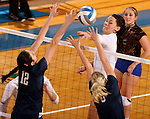 BROOKINGS, SD - NOVEMBER 14:  Tiara Gibson #7 from South Dakota State University tips the ball against Jovana Poljasevic #12 and Sofia Redden #10 from Oral Roberts University during their volleyball match Friday night at Frost Arena. (Photo by Dave Eggen/Inertia)
