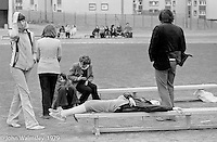 It was a bitterly cold and windy day in June, Sports Day at the Education Centre, Wester Hailes, Scotland, 1979.  John Walmsley was Photographer in Residence at the Education Centre for three weeks in 1979.  The Education Centre was, at the time, Scotland's largest purpose built community High School open all day every day for all ages from primary to adults.  The town of Wester Hailes, a few miles to the south west of Edinburgh, was built in the early 1970s mostly of blocks of flats and high rises.