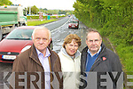 N69: Cllr Tim Buckley with locals, Peggy O'Connell and Maurice Murphy survey the deteriorating road surface near Kerry Ingredients on the Tralee road in Listowel.