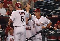 Apr 11, 2007; Phoenix, AZ, USA; Arizona Diamondbacks shortstop (6) Stephen Drew is congratulated by his teammates after scoring in the first inning against the Cincinnati Reds at Chase Field in Phoenix, AZ. Mandatory Credit: Mark J. Rebilas