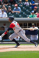 Emilio Bonifacio (18) of the Gwinnett Braves follows through on his swing against the Charlotte Knights at BB&T BallPark on May 22, 2016 in Charlotte, North Carolina.  The Knights defeated the Braves 9-8 in 11 innings.  (Brian Westerholt/Four Seam Images)