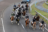 "Pictured: Mourners ride their horses towards Margam Crematorium, Wales, UK. Monday 08 October 218<br /> Re: A grieving father will mourners on horseback at the funeral of his ""wonderful"" son who killed himself after being bullied at school.<br /> Talented young horse rider Bradley John, 14, was found hanged in the school toilets by his younger sister Danielle.<br /> Their father, farmer Byron John, 53, asked the local riding community to wear their smart hunting gear at Bradley's funeral.<br /> Police are investigating Bradley's death at the 500-pupils St John Lloyd Roman Catholic school in Llanelli, South Wales.<br /> Bradley's family claim he had been bullied for two years after being diagnosed with Attention Deficit Hyperactivity Disorder.<br /> He went missing during lessons and was found in the toilet cubicle by his sister Danielle, 12."