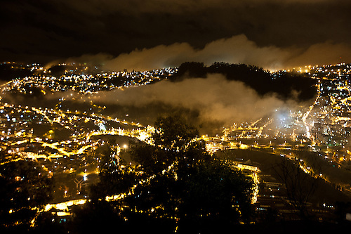 A fog rolls in over the mountainous city of Quito, in the Ecuadorian Andes.