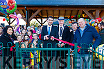 Minister Brendan Griffin cuts the tape to officially open the new children's play ground in the middle of Castlegregory last Sunday morning, beside him L-R is the Deputy Mayor of Kerry, Dan McCarthy, Vincent Foley, Kerry County Council and Keith Woodword, Chairman of the Playground Committe.