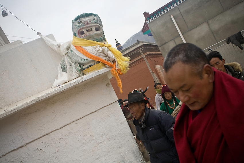 Some tibetan pilgrims around a stupa in the monastery of Labrang (Xiahe) where some riots have erupted in march 2008. Since then the town has been closed to foreigners and only reopened in october. The town is under stress while trials and condamnations are settling in november. At the entries of the monastery two videocameras are now monitoring the streets.