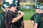 Hughesville High School coach giving tips to his players