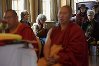NWA Democrat-Gazette/CHARLIE KAIJO Visitors listen to University of Arkansas Assistant Clinical Professor and monk Geshe Dorjee and monk Yeshi Topgyal of Minnesota, Minn. chant during the Creation of the Healing Sand Mandala ceremony, Sunday, November 4, 2018 at the Basin Park Hotel in Eureka Springs.<br />