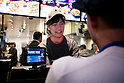 A member of staff takes orders from the press members during the pre-opening event for the restaurant's first Japanese store located in Tokyo's Shibuya district, on April 20, 2015, Japan. The store includes Japan specific dishes like shrimp and avocado burrito and taco rice on its menu. It will open to the public on April 21st. The American Tex-Mex fast food restaurant has signed a franchise agreement with Asrapport Dining Co., Ltd. to operate Taco Bell branches in Japan. (Photo by Rodrigo Reyes Marin/AFLO)