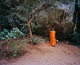 SRI LANKA, Asia, young monk standing in Pidurangala temple
