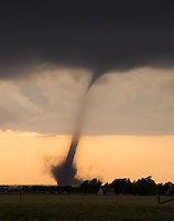 A rare anticyclonic tornado strikes the El Reno Oklahoma airpark damaging a hangar and several airplanes on April 24th, 2006.