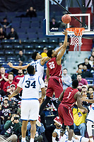 Washington, DC - MAR 10, 2018: Saint Joseph's Hawks forward James Demery (25) goes up for a lay up over Rhode Island Rams guard Jeff Dowtin (11) during the semi final match up of the Atlantic 10 men's basketball championship between Saint Joseph's and Rhode Island at the Capital One Arena in Washington, DC. (Photo by Phil Peters/Media Images International)