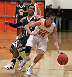 Douglas' Austin Evans works against Manogue defender Kenny Rogers during a boys basketball game between Bishop Manogue and Douglas High in Minden, Nev., on Thursday, Dec. 22, 2011..Photo by Cathleen Allison