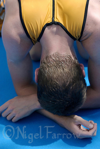 21 JUN 2003 - KARLOVY VARY, CZECH REPUBLIC - A competitor recovers at the end of the European Junior Mens Triathlon Championships. (PHOTO (C) NIGEL FARROW)