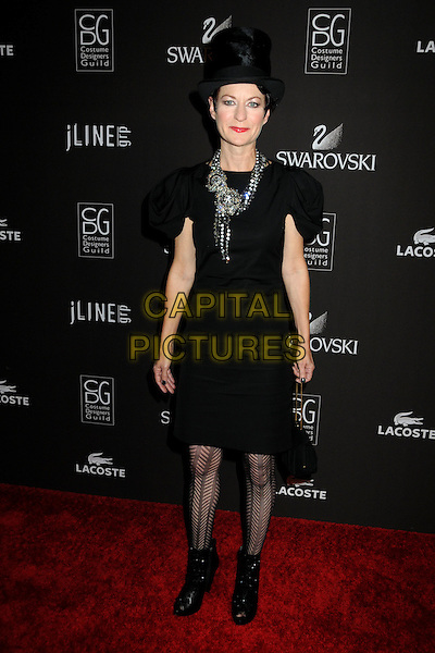 LOU EYRICH .Attending the 12th Annual Costume Designers Guild Awards held at the Beverly Hilton Hotel.  .Beverly Hills, California, USA,  .25th February 2010 .arrivals full length black dress patterned pattern tights hat ankle boots necklace  .CAP/ADM/BP.©Byron Purvis/AdMedia/Capital Pictures.