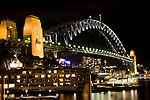 The Sydney Harbor lit up at night in Sydney, New South Wales, Australia