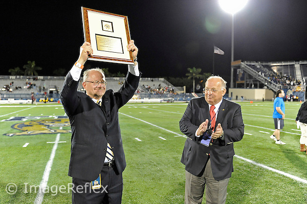 6 November 2010:  FIU President Mark B. Rosenberg is presented with a plaque from the Sun Belt Conference during halftime as the FIU Golden Panthers defeated the University of Louisiana-Monroe Warhawks, 42-35 in double overtime, at FIU Stadium in Miami, Florida.