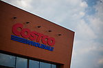 Costco Wholesale Corp. signage is displayed in front of a newly opened Costco warehouse in Villebon-Sur-Yvette, France, on Saturday, July 7, 2018. The 150,000-square foot warehouse, which opened last month just outside of Paris, is Costco's first store in France. Costco plans to open 15 more warehouses in France by 2025. Photograph by Michael Nagle