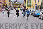 RACE: Jimmy Kelly (Greyhound Bar) and John Evans ahead of Keith Daly (Linanes Bar), and Dominic O'Brien(Castle Bar) as they reach the finish line in the Rock Bars Street Race on Monday.