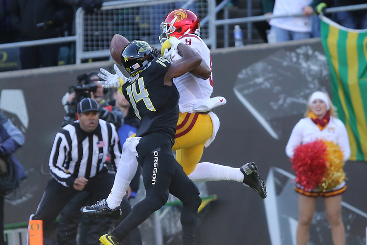 Nov 21, 2015; Eugene, OR, USA; Oregon Ducks cornerback Ugo Amadi (14) breaks up a pass to USC Trojans wide receiver JuJu Smith-Schuster (9) at Autzen Stadium. <br /> Photo by Jaime Valdez