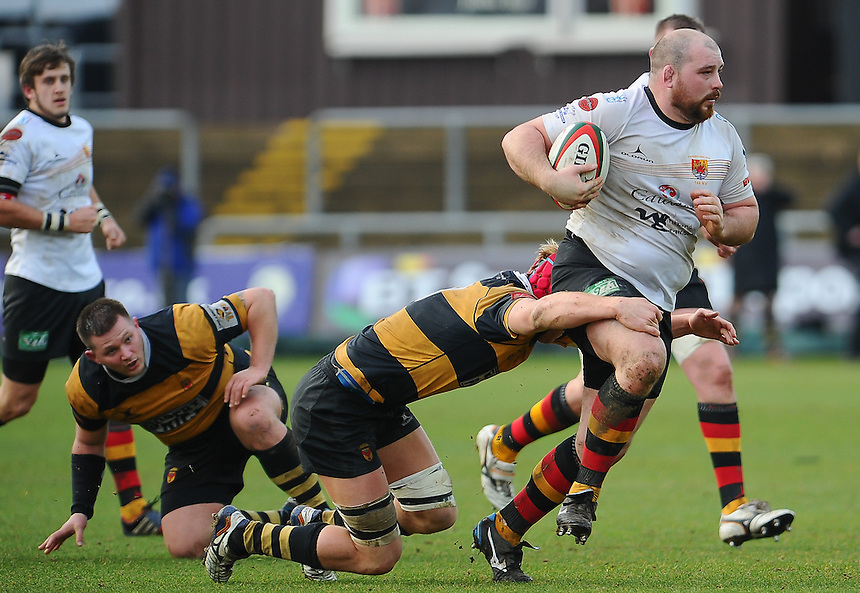 Carmarthen Quins' Ian Jones is tackled by Newports' Sam Cross <br /> <br /> Photographer Craig Thomas/CameraSport<br /> <br /> Rugby Union - Rugby Union - Welsh Premier Division - Principality Premiership - Newport RFC v Carmarthen Quins - Saturday 17th January 2015 - Rodney Parade - Newport<br /> <br /> &copy; CameraSport - 43 Linden Ave. Countesthorpe. Leicester. England. LE8 5PG - Tel: +44 (0) 116 277 4147 - admin@camerasport.com - www.camerasport.com