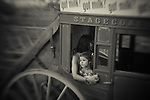 A girl looks out from a stagecoach during the Reno Rodeo on Saturday, June 29, 2013 in Reno, Nevada<br /> (Photo by Kevin Clifford)