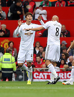 Pictured L-R: Ki Sung Yueng celebrating his goal with team mate Jonjo Shelvey. Saturday 16 August 2014<br />