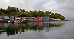 The harbor of Tobermory, Scotland is well known by children as the famous Balamory.  This is a very colorful village scene with a reflection in the water.