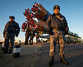 Security monitors the Soyuz TMA-11M rocket as it is rolled out to the launch pad by train on Tuesday, Nov. 5, 2013, at the Baikonur Cosmodrome in Kazakhstan. Launch of the Soyuz rocket is scheduled for November 7 and will send Expedition 38 Soyuz Commander Mikhail Tyurin of Roscosmos, Flight Engineer Rick Mastracchio of NASA and Flight Engineer Koichi Wakata of the Japan Aerospace Exploration Agency on a six-month mission aboard the International Space Station.  <br /> Mandatory Credit: Bill Ingalls / NASA via CNP