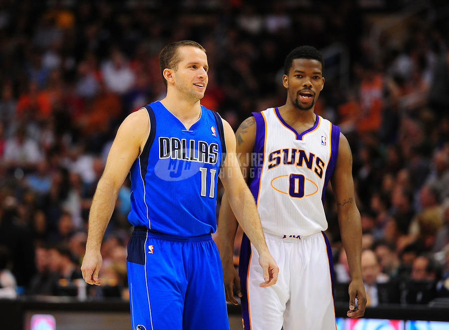 Mar. 27, 2011; Phoenix, AZ, USA; Dallas Mavericks guard (11) Jose Barea against Phoenix Suns guard (0) Aaron Brooks at the US Airways Center. Mandatory Credit: Mark J. Rebilas-