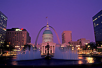 St. Louis, MO, Missouri, View of the Old Courthouse and Gateway Arch from fountain at Kiener Plaza in downtown Saint Louis in the evening. Jefferson National Expansion Memorial.