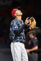 Jacksonville Jumbo Shrimp relief pitcher Jorgan Cavanerio (18) looks skyward while he walks off the field during a game against the Mobile BayBears on April 14, 2018 at Baseball Grounds of Jacksonville in Jacksonville, Florida.  Mobile defeated Jacksonville 13-3.  (Mike Janes/Four Seam Images)