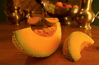 Landscape of Cantaloupe Melon Slice, on a pine table in a kitchen