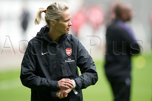 21.04.2013. Wolfsburg, Germany.  Arsenal's coach Shelley Kerr checks her watch prior to the match VfL Wolfsburg - Arsenal LFC in the Volkswagen Arena in Wolfsburg, Germany, 21 April 2013.