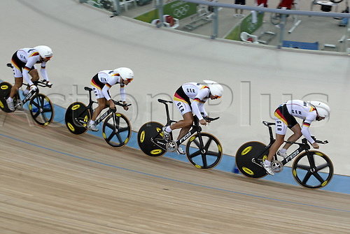 23 August 2004: The German team of Robert Bartko, Guido Fulst, Christian Lademann and Leif Lampater ride against Spain in the bronze medal race of the Men's Team Pursuit held in the Olympic Velodrome. Spain went on to win the bronze medal. 2004 Olympic Games, Athens, Greece. Photo: Neil Tingle/Action Plus...040823 olympics olympic bicycle bike track cycling velodrome teamwork