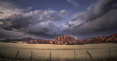 Passing storm clouds appear at sunset over Kolob Terrace at Zion National Park, Utah