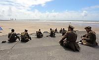 Men in World War I gear having lunch by Aberavon beach, Port Talbot, south Wales UK. Friday 01 July 2016
