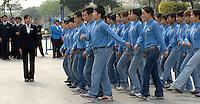 Shop employees marching outside their mall, as a part of training, in Guangdong Province, China..