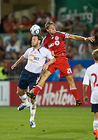 21 July 2010:  Bolton Wanderers Andy O'Brien No. 2 and Toronto FC Bas Ent No. 28 in action during the Carlsberg Cup game between the Bolton Wanderers and Toronto FC at BMO Field in Toronto..Bolton Wanderers FC  won on penalties.
