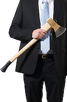 businessman ready to put an axe to work and chop to make the business healthy