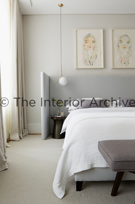A neutral palette of grey and off-white makes for a timeless and elegant design in the bedroom. Bespoke upholstery and subtle and unfussy furniture complete the elegant look.