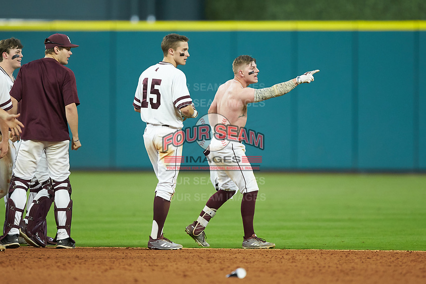 Hunter Stovall (right) points to fans in the stands following his walk-off sacrifice fly in the bottom of the 12th inning against the Houston Cougars in game six of the 2018 Shriners Hospitals for Children College Classic at Minute Maid Park on March 3, 2018 in Houston, Texas. The Bulldogs defeated the Cougars 3-2 in 12 innings. (Brian Westerholt/Four Seam Images)