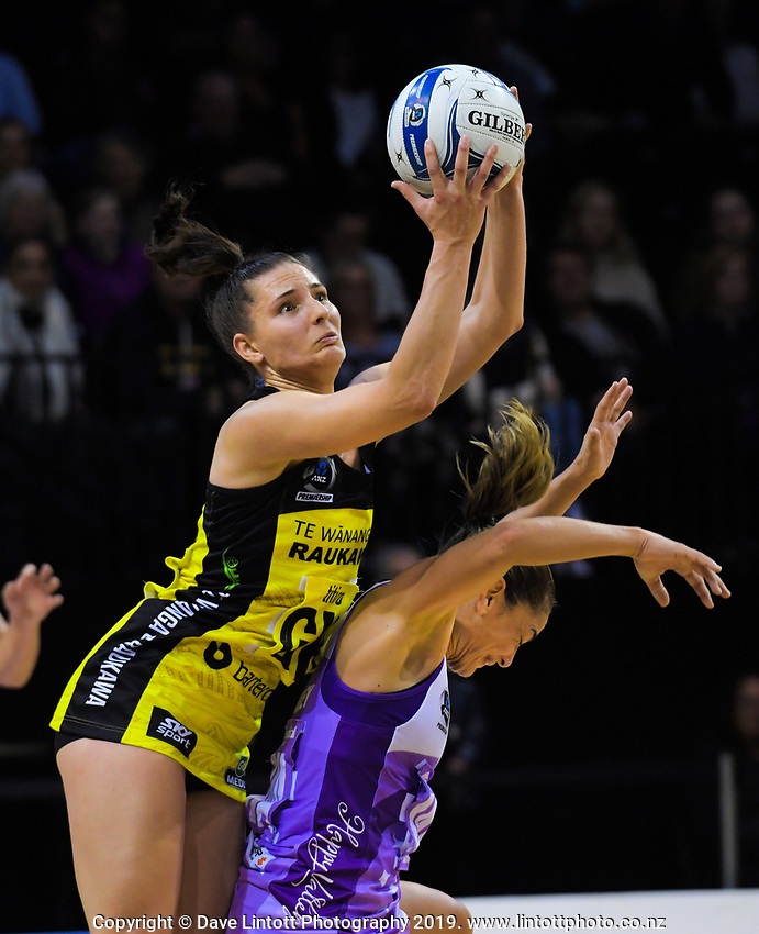 Karin Burger takes a pass under pressure from Temepara Bailey during the ANZ Premiership netball match between the Central Pulse and Northern Stars at the TSB Bank Arena in Wellington, New Zealand on Monday, 13 May 2019. Photo: Dave Lintott / lintottphoto.co.nz