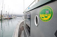 A charter boat leaves the Seward, Alaska, small boat harbor to fish for halibut.