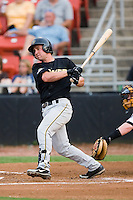 West Virginia second baseman Kenny Holmberg (22) follows through on his swing versus Hickory at L.P. Frans Stadium in Hickory, NC, Friday, August 24, 2007.