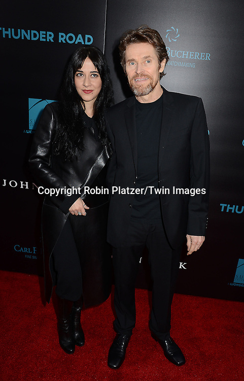 Willem Dafoe and wife Giada Colagrande attend the Special Screening of &quot;John Wick&quot;  on October 13, 2014 at the Regal Union Square Stadium 14 in New York City.<br /> <br /> photo by Robin Platzer/Twin Images<br />  <br /> phone number 212-935-0770