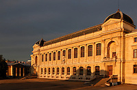 View from the side at sunrise of the Grande Galerie de l'Evolution (Great Gallery of Evolution), built by Jules Andre from 1877 to 1889 and located in the Jardin des Plantes, Paris, 5th arrondissement, France. Founded in 1626 by Guy de La Brosse, Louis XIII's physician, the Jardin des Plantes, originally known as the Jardin du Roi, opened to the public in 1640. It became the Museum National d'Histoire Naturelle in 1793 during the French Revolution. Picture by Manuel Cohen